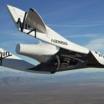 the Virgin Galactic SpaceShip2 (VSS Enterprise)  glides toward earth on its first test flight after release from the mothership,