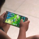 DEZHOU, CHINA - JULY 02:  A child plays online game 'Honor of Kings' on July 2, 2017 in Dezhou, Shandong Province of China. China's Tencent will restrict each account's daily playtime of its popular role-playing mobile game 'Honor of Kings', the developers said on Sunday. Children under 12 will be allowed to play the game for no more than an hour a day, and adolescents over 12 years old can play for two hours a day starting from Tuesday. It's an attempt to prevent them from online game addiction.  (Photo by VCG/VCG via Getty Images)
