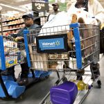 Shoppers push carts through the grocery department at a Wal-Mart Stores Inc. location in Chicago, Illinois, U.S., on Wednesday, Nov. 25, 2015. In 2011, several big U.S. retailers moved their opening times to midnight; in 2012, Wal-Mart crossed the Rubicon and opened its stores at 8 p.m. on Thanksgiving Day. But after last year's Thanksgiving weekend retail sales fell 11 percent from the year before while overall holiday sales rose, some retailers have been reconsidering. Photographer: Daniel Acker/Bloomberg